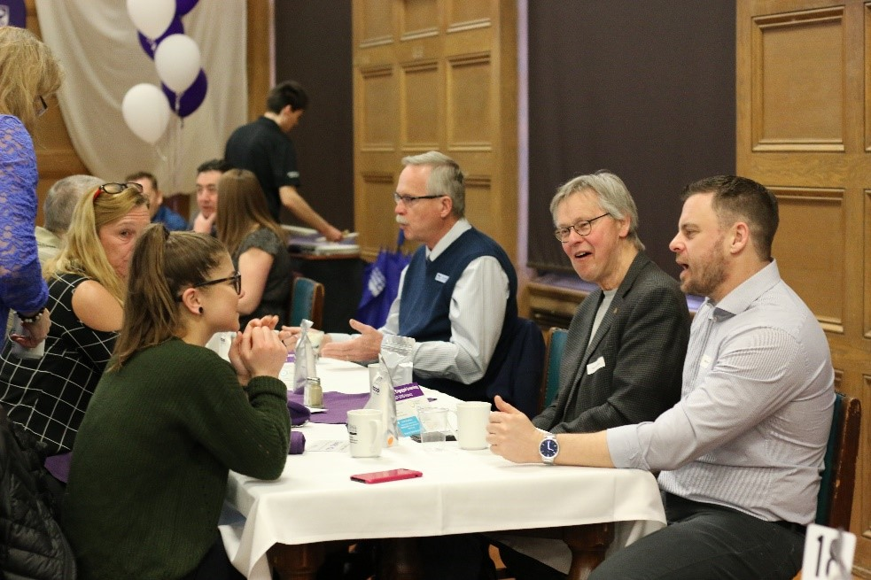 Group of stakeholders reflect upon and celebrate experiential learning at Western University.
